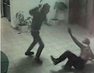 A scene from the security camera video shows the Palestinian terrorist attacking the Israeli security guard with an axe.