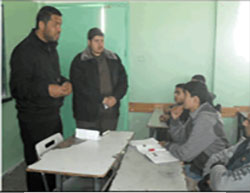 Representatives from the political guidance administration of the Hamas-controlled ministry of the interior in the Gaza Strip visit the school and speak to the children