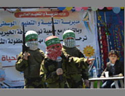 Gazan children put on a display during the 8th Children's Festival. Its objective was to make them identify with the Izz al-Din Qassam Brigades, Hamas' military-terrorist wing.