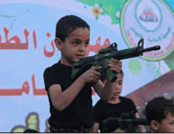 Kindergarten children engage in a variety of military activities (Facebook page of the Islamic Association in Khan Yunis, May 6, 2016).