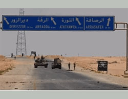 "Syrian Army presence in the important Al-Rasafeh junction. On the side of the road (on the right) there is an ISIS sign that reads ""There is No God but Allah - the Islamic State - Al-Raqqah Province"" (SANA News Agency, June 12, 2016)."