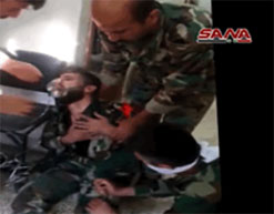 Syrian soldier injured by chemical weapons wearing an oxygen mask.