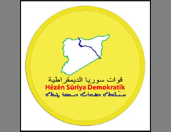 The SDF logo (Facebook page of the SDF, March 11, 2016). The upper inscription is in Arabic, the middle in Kurdish and the lower in Syriac.