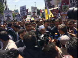 Iranian President Hassan Rouhani in a Global Jerusalem Day procession in Tehran