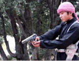 Boy executing one of the Taliban operatives captured by ISIS.