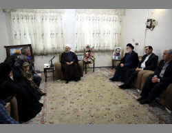 President Rouhani at the home of the family of Hamid Reza Asadollahi