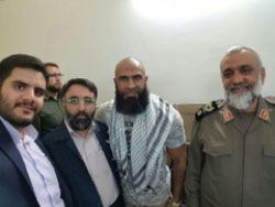 Basij commander Mohammad Reza Naghdi (right) and Ayyub Hassan Faleh al-Rubaie (Abu Azrael), commander of the Iraqi Shi'ite militia (second from right) in Mashhad in Iran