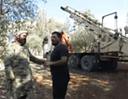 One of the Jaysh al-Fatah commanders near a truck belonging to a heavy artillery battery (YouTube, July 31, 2016)