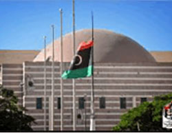 Libyan flag flying at the Conference Center (Twitter, August 10 and 12, 2016)