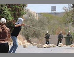 Masked Palestinians throw stones at IDF soldiers in the village of Qadoum (Twitter account of Quds.net, August 26, 2016).