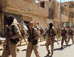 ISIS operatives march through the main street of the village of Abu Kamal  (Amaq, September 25, 2016).