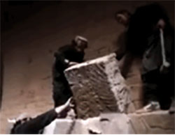 Destroying antiquities in the city of Nimrud after its takeover by ISIS (Haqq, April 11, 2015)