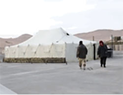 ISIS operatives near the tents in the Russian base compound in Palmyra (Aamaq, December 13, 2016)