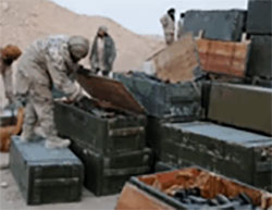 ISIS operatives examining crates of ammunition in the Russian base in Palmyra.