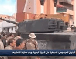 Tank with the Libyan flag in Sirte's Marine neighborhood, the last stronghold retaken from ISIS operatives (Libya Mubasher Channel, December 5, 2016).