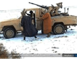 ISIS operatives near an off-road vehicle with an anti-aircraft gun on the outskirts of the T-4 military airfield.