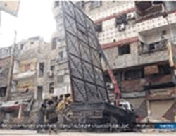 Erecting metal barricades to prevent sniper fire in the Al-Yarmouk refugee camp  (justpaste.it, December 15, 2016)
