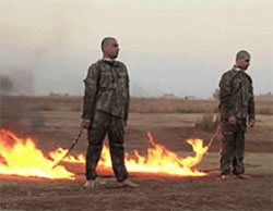 Two Turkish soldiers who were captured by ISIS, a moment before they are executed by burning (Haqq, December 23, 2016).