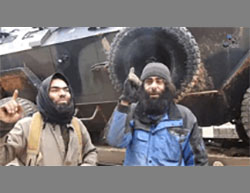 Photos from a video released by ISIS, showing a Turkish Army APC seized west of Al-Bab (Haqq; Aamaq through a YouTube account, December 29, 2016).