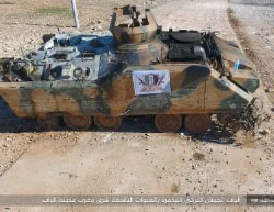 Turkish Army APC hit by an ISIS-planted IED. A Free Syrian Army flag is hanging on the APC (Haqq, February 3, 2017)