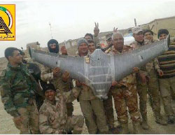 Shiite militia operatives holding an ISIS drone which they claim to have shot down (Facebook page of the Shiite militias, January 31, 2017)