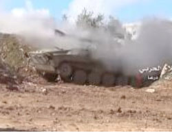 Syrian Army tank fires at the rebel forces in Manshiya.