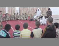 Yazidi children forcibly converted to Islam undergoing religious indoctrination by ISIS operatives.