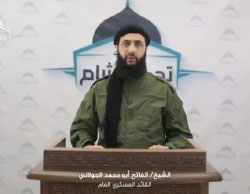 Abu Mohammad al-Julani, the military commander of the Headquarters for the Liberation of Al-Sham, reading his organization's claim of responsibility for the terrorist attack in Homs (YouTube, February 27, 2017).