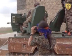 Kurdish soldiers firing at the Euphrates Shield forces advancing towards Manbij (website of the Military Council of Manbij and its Outskirts, March 7, 2017)