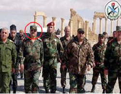 Syrian Defense Minister Fahd Jassem al-Freij (marked with a circle), during a visit at the Old City of Palmyra after its liberation from ISIS (Syrian TV, March 4, 2017)