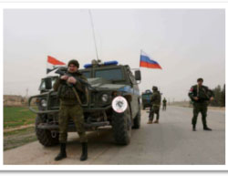 Vehicles of Russian forces in the Manbij area, with Russian and Syrian  flags (Twitter, March 11, 2017)