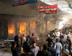 Stores on fire in Al-Nabi open market as a result of ISIS mortar fire (Nineveh Information Center, March 26, 2017)