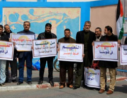 Protest demonstration in front of the offices of UNRWA's education administration in the western part of Khan Yunis. The signs read,