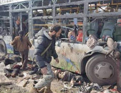 Bodies of children from the villages of Al-Fu'ah and Kafraya and a destroyed bus at the scene of the attack. Left: charred cars at the scene (Haqq, April 15, 2017)