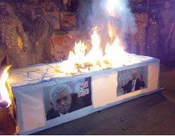 Hamas operatives burn a coffin decorated with an Israel flag and pictures of Mahmoud Abbas and Palestinian Prime Minister Rami Hamdallah. It occurred during a protest demonstration in the central Gaza Strip motivated by the rising tension between the PA and Hamas.