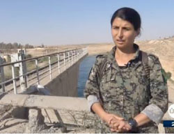 Jihan Sheikh Ahmad, spokeswoman of Operation Euphrates Wrath, standing near the Tabqa Dam, reports about the liberation of the city of Tabqa and the Tabqa Dam from ISIS (Al-Aan Channel, May 10, 2017).