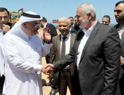 Ismail Haniyeh (right), newly-elected head of Hamas' political bureau, shakes hands with Muhammad al-'Amadi, chairman of Qatar's Committee for the Reconstruction of the Gaza Strip, at the laying of the corner stone for the committee's offices in the Gaza Strip (Palinfo Twitter account, May 21, 2017).
