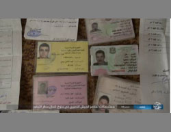 ID cards of Syrian Army soldiers killed fighting with ISIS north of the T-4 military airfield.