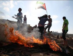 Gazans clash with IDF forces at the border security fence following a Hamas call to hold a week of demonstrations on the Israeli-Gazan border to protest the
