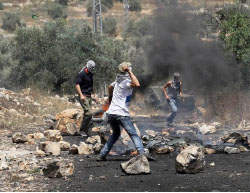 Palestinians throw rocks at Israeli security forces in the village of Qadoum during the weekly riot (Palinfo Twitter account, June 9, 2017).