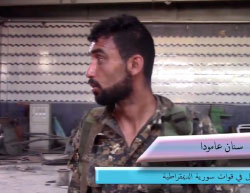 SDF fighter at an ISIS car bomb workshop which has been located in searches at Al-Mashlab neighborhood (YouTube, June 13, 2017).