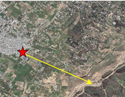 Location of two UNRWA-run schools (indicated by the red star) in the al-Maghazi refugee camp in the central Gaza Strip, where a tunnel was exposed. The school is located on the edge of the camp and is about 1.5 kilometers (less than a mile) from the Israeli border security fence (distance indicated by yellow arrow) (Wikimapia, June 12, 2017).