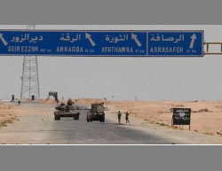 "The advance of the Syrian Army towards Al-Rasafah: ISIS's sign (right) reading ""the Al-Raqqah Province"" is still there (Syrian Al-Ittihad Press website, June 19, 2017)"