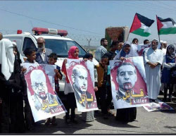 Palestinians demonstrate on the Gazan side of the Erez crossing for permission to leave the Gaza Strip for medical treatment abroad.