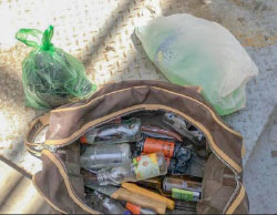 The bag found in the car containing shock grenades, Molotov cocktails and knives  (Israel Police Force spokesman, July 4, 2017).