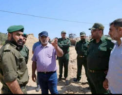 Tawfiq Abu Na'im, deputy minister of the interior in the Gaza Strip, oversees the construction work on the ground (Facebook page of the ministry of the interior in the Gaza Strip, June 28, 2017).