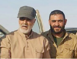 Qassem Soleimani (left, wearing a hat) visiting near the Syrian-Iraqi border, south of Deir ez-Zor. Next to him is Khaled al-Marei, commander of the Al-Baqer Brigade, a Shiite militia from the Aleppo area supprting the Syrian regime (Qasiyoun, July 8, 2017).