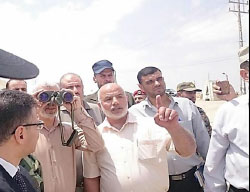 Yahya al-Sinwar (holding binoculars) pays a visit to the Rafah-Egypt border for a first-hand look at the construction of the buffer zone (Facebook page of the Hamas ministry of the interior in the Gaza Strip, July 5, 2017).