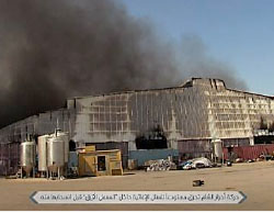 Food warehouse in the Blue Factory compound near the Bab Al-Hawa border crossing, which was set on fire by the Ahrar Al-Sham operatives before they had withdrawn, leaving the area for the Headquarters for the Liberation of Al-Sham operatives (Twitter account of Ibaa News Agency, July 21, 2017).
