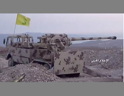 : Gun mounted on a Hezbollah truck fires artillery at outposts of the Headquarters for the Liberation of Al-Sham in the area of Arsal.